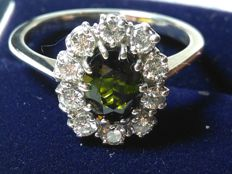 Gold cocktail ring (18 kt)  with peridot and natural diamonds totalling 2 ct