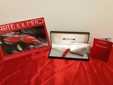 Ferrari - Lot consisting of paper knife - brochure for centenary of Enzo Ferrari's death - 70-year notebook/passport with details of Maranello factory
