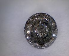 0.52 ct brilliant cut diamond, brownish silver I3.
