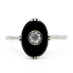 Art Deco ring featuring a  0.20 ct old European cut Diamond set in  Onyx, in 14k white gold.