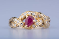 Ring in 18 kt yellow gold with 1 pear-cut ruby approx. 0.40 ct, 27 diamonds approx. 0.27 ct; Size: EU 54, US 6 3/4