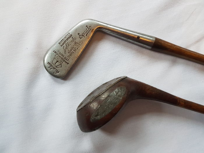 Antique golf club and wooden driver, signed, hickory wood shaft and leather grip, England, ca. 1900