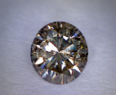 0.62 ct brilliant cut diamond, fancy brown, SI2.