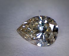 0.55 ct pear cut diamond, light brown SI1.