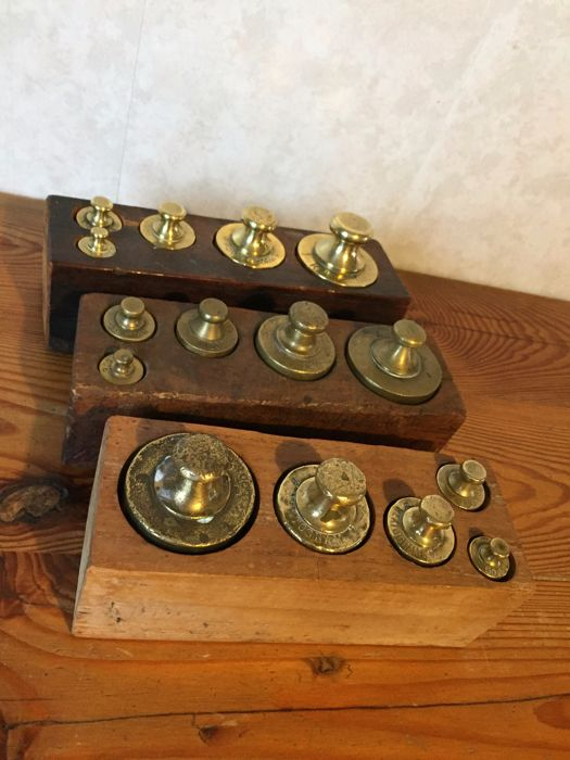 Three blocks with five button weights - end 19th century