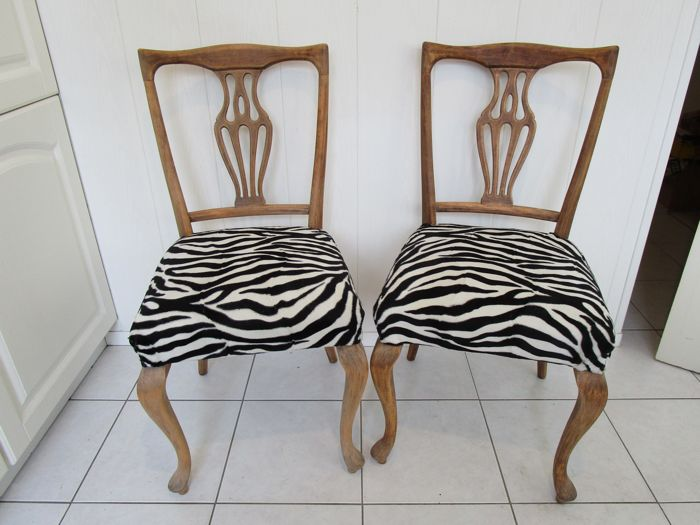 Two chairs with wood carvings in Art Nouveau style