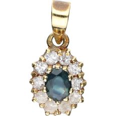 14 kt Yellow gold pendant set with sapphire and zirconia. - length x width: 1.5 x 0.8 cm