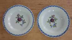 A pair of French faience plates