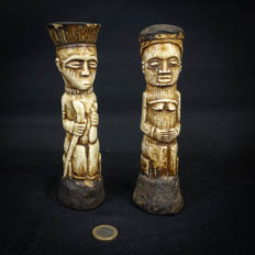 2 Figures Carved in Bone