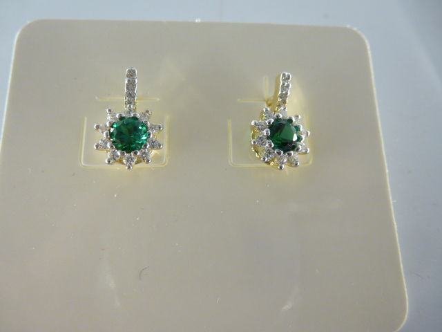 14 kt gold earrings with tourmalines and white sapphires