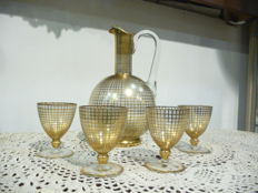 Decanter and 4 glasses, decorated with gold
