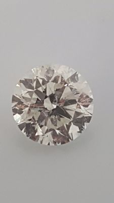 1.12 ct - Round Brilliant - White - E / SI1