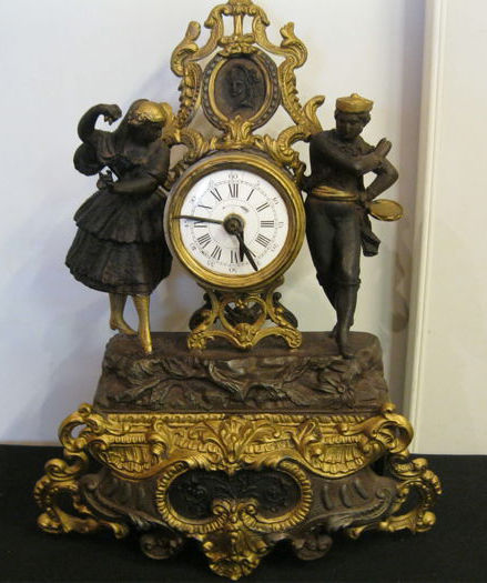 French metals and copper pendulum clock with alarm clock as movement - classic style depicting a dancing couple, ca. 1920