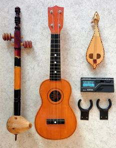 3 handmade string instruments, including a Ukulele & 3 accessories