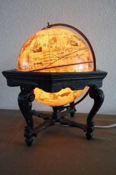 Old nostalgic globe with antique map - with lighting