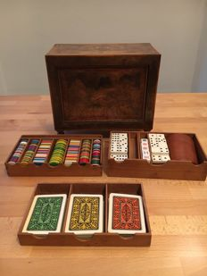 Lovely root wood cabinet from the 1950s containing playing cards, dominoes, dice and casino tokens
