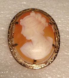 Gold vintage pink shell cameo pendant or brooch with a woman's portrait