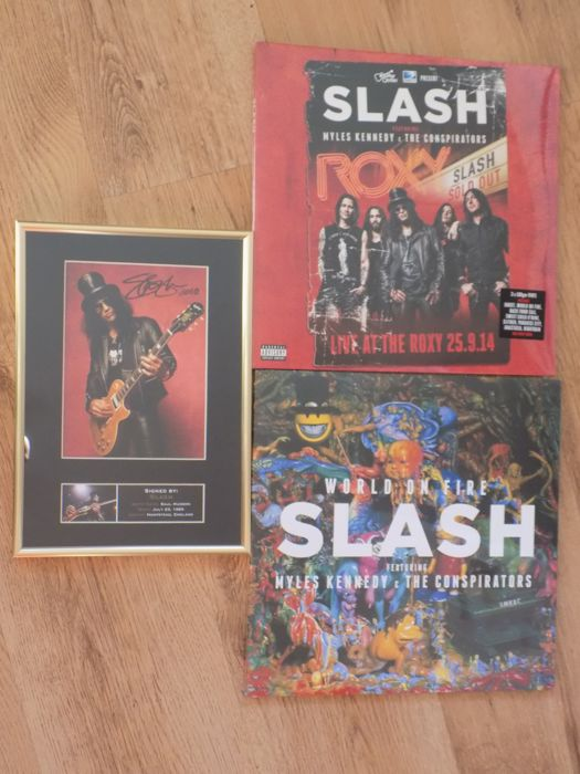 """Slash """" World On Fire """" Double LP , """" Live At The Roxy 25/09/14 """" Triple LP & Slash framed photograph display with printed signature."""