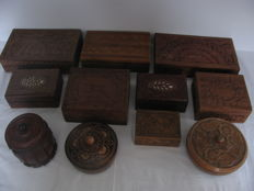 Lot with 11 wooden boxes and cases, hand-carved, with brass and 2 with bone inlays