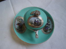 Meissen - a porcelain cup with saucer