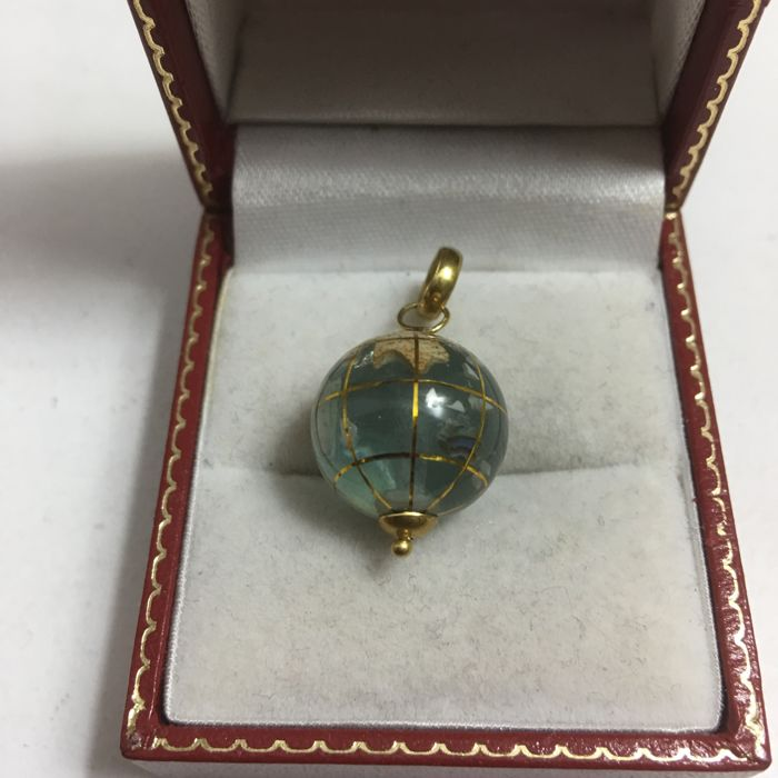 18k Gold Pendant: translucide water like rotating earth globe made from and inlay of  realistic world parts of various precious stones, globes