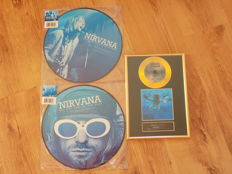 """Nirvana """" All The Fun Of The Fair """" picture disc LP, """" Down On A Saturday Night """" picture disc LP & framed """" Nevermind """" gold coloured CD with printed signatures."""