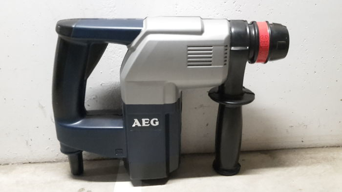 Large advertisement of AEG electric tools. Logo AEG. AEG advertisement. Made in Germany.