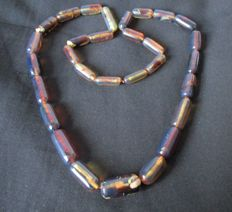 Blue amber necklace. 68 g 30 fluorescent beads.