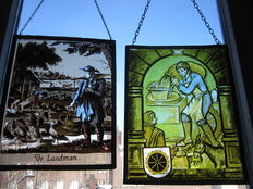 "Two gorgeous old hand painted stained glass suncatcher of ""De Landman"" and ""De Molenaar"" - 20th century"