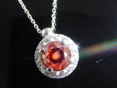 White gold, entourage pendant, set with exclusive, intense, fancy,  deep-red coloured, brilliant cut diamonds, 0.60 ct and 14 diamonds, 0.80 ct in total.