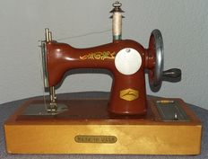 Children's sewing machine with original packaging.