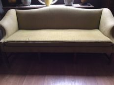 A Georgian style Chippendale camelback Sofa, early 20th, wanting new upholstery