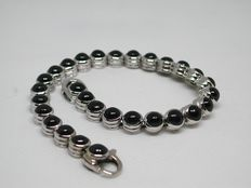 Men's bracelet set with sapphire cabochons - 29.00 ct in total.