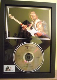 Jimi Hendrix, framed photo and  CD disc. 'Purple Haze', Track Records label.