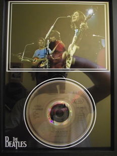 The Beatles, framed photo and  CD disc. 'Revolution', Apple label.