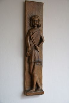 Cut from 1 piece of wood, wooden wall panel depicting a medieval musician