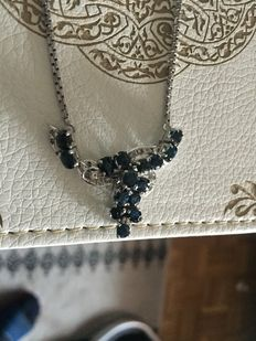 Silver necklace with sapphires.