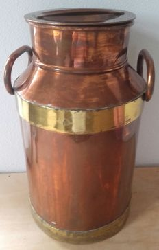 Old copper-plated milk churn