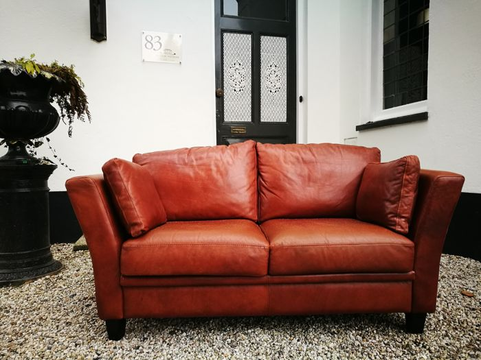 Designer Unknown   Two Seater Cowhide Couch (handmade)