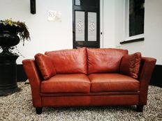 Designer unknown - two seater cowhide couch (handmade)