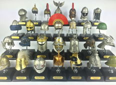 Collection of 34 historical metalic helmets - 20th century