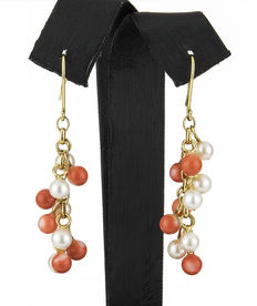 Long yellow gold dangle earrings with Pacific coral beads and pearls.