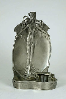Pewter Jugendstil style candlestick with decorations of a young lady.