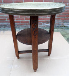 Elegantly shaped wooden side table with copper table top from the 1940s / 1950s