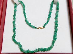 Gold necklace with emerald