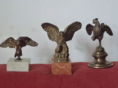 """1 Art Deco Sculpture of an eagle with its wings spread in bronze on red marble base signed """"Romi"""" -1 Empire Sculpture of an eagle with wings spread in bronze on base of white Carrara marble-1 Liberty Sculpture of a rooster with wings spread on conic base"""