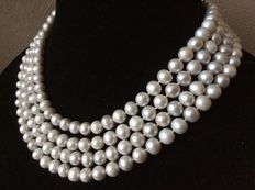 Long necklace with silver grey natural freshwater baroque pearls.