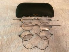 Three antique spectacles with storage case, around 1920/1940.