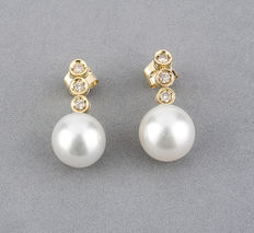 Yellow gold earrings set with brilliant cut diamonds in stud setting, and pearls.