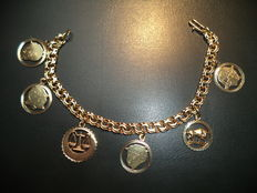 Gold bracelet with 6 charms